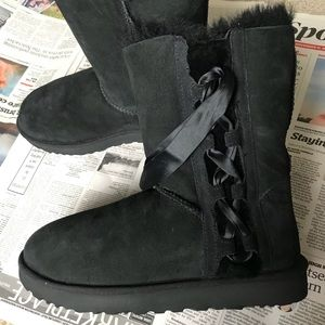 Ugg side lace up style  booties.